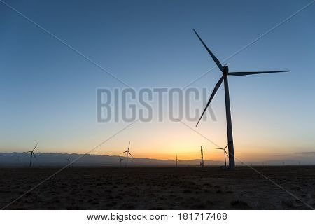 wind farm in sunset on wilderness qinghai China