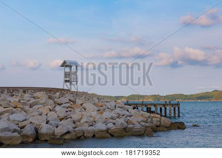 Lifeguard stand on seacoast skyline natural landscape background