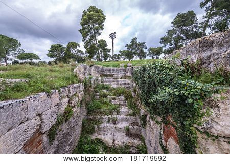Ancient Amphitheater from Roman period in Neapolis Archaeological Park in Syracuse Sicily Island of Italy