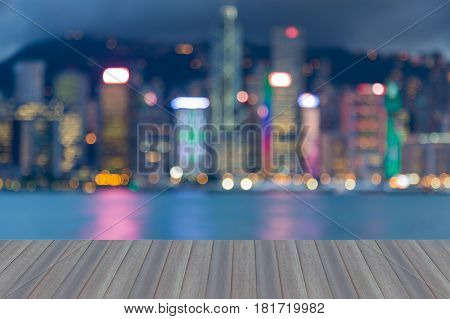Opening wooden floor Twilight blurred bokeh Hong Kong city downtown over the Bay abstract background
