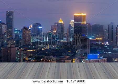 Opening wooden floor Night office building light aerial view cityscape downtown background