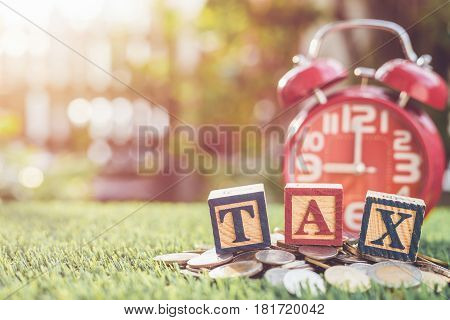 Tax Write In Color Alphabet Wood Box On Stack Of Thai Baht Coin And Red Alarm Clock With Left Free S