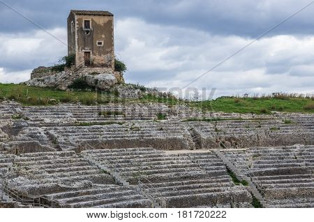 Ruins of Greek theater in Neapolis Archaeological Park in Syracuse Sicily Island of Italy