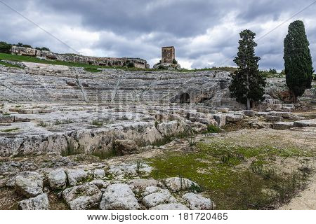 Greek theater ruins in Neapolis Archaeological Park in Syracuse Sicily Island of Italy
