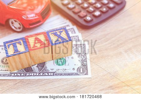 Tax Write In Color Alphabet Wood Box On Us Dollar And Red Car, Calculator.