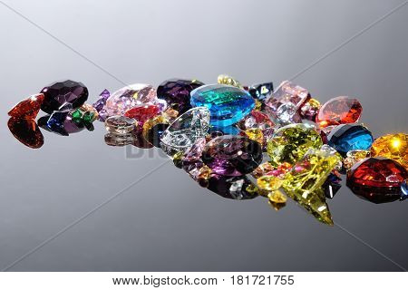 Colorful Of Different Gemstones With Space For Text On Gray Background.