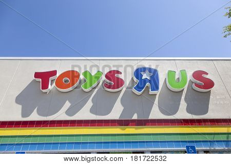 Naples Fl USA - March 19 2017: Toys R Us corporate logo on a branch store in the city of Naples. Florida United States
