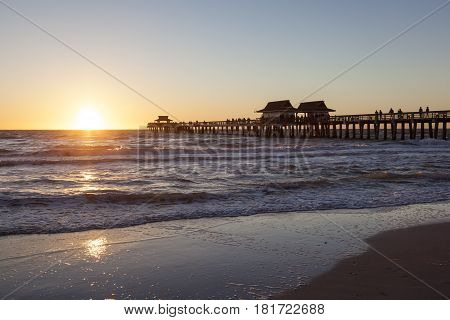 Silhouette of the fishing pier in Naples at sunset. Florida United States