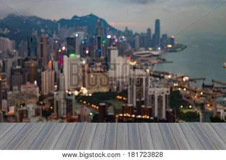 Opening wooden floor Aerial view blurred bokeh light Hong Kong city office downtown abstract background