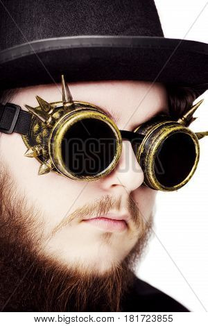 Handsome Young Man With Long Beard And Moustache On Face In Steampunk Glasseses On White Background