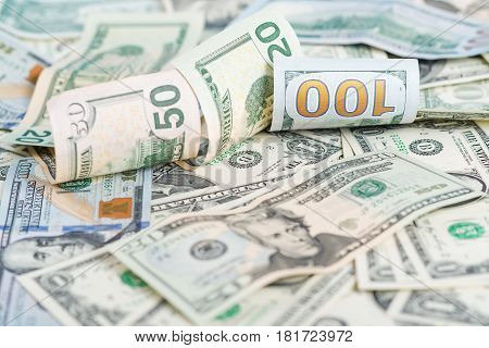 Background from the scattered dollar a banknotes.