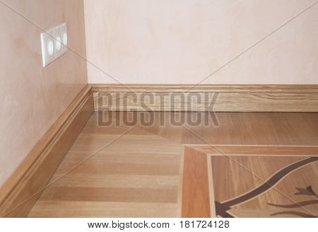 Wood Flooring. Skirting Board Oak Wooden Floor . Flooring with Wooden Batten Repair.