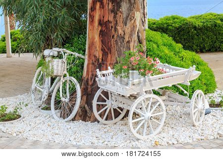 Vintage bicycle and horse cart with flowers