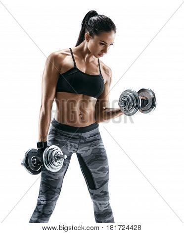 Muscular woman doing exercises with dumbbells at biceps. Photo of strong female isolated on white background. Strength and motivation.