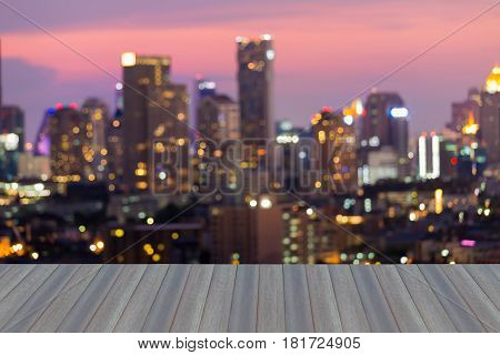 Opening wooden floor Blurred bokeh light office building with beautiful sky abstract background