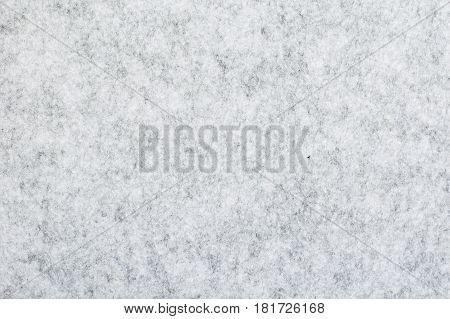 Closeup of gray melange felt texture for background