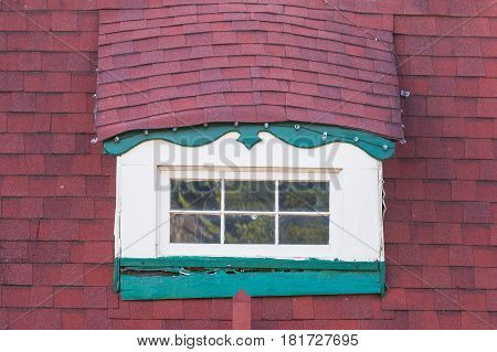 The window on the roof of attic in the building in German style Helen USA
