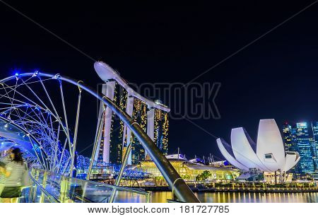 SINGAPORE - JULY 82016 : Helix Bridge and Marina Bay Sand Hotel at night time landmark in Singapore.