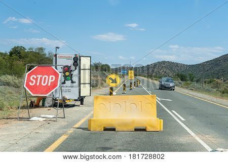WILLOWMORE SOUTH AFRICA - MARCH 23 2017: A traffic control point at roadworks on the N9 road near Willowmore in the Eastern Cape Province