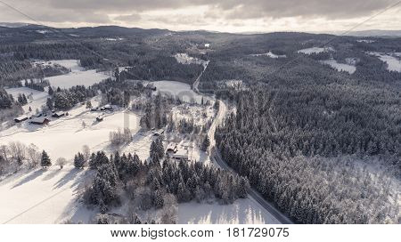 Aerial view of snowy rural winter landscape.