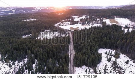 Aerial view of a winding rural road at sunset