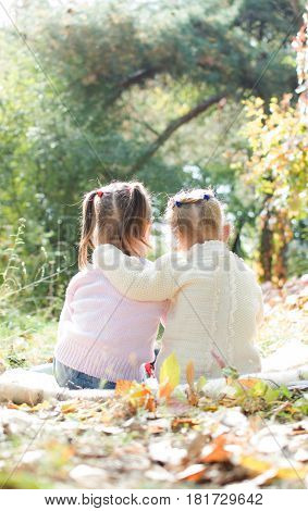 Portrait Of Two Girls Sitting Together Embracing In The Woods. The Sisters. Best Friends. On Open Ai