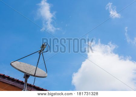 Satellite dish on the roof with a beautiful blue sky background.