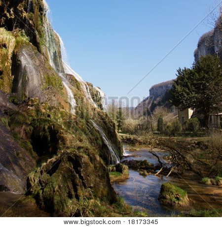 waterfall in mossy stones