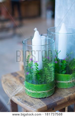 White big candles in glass. Simple creative ideas for home and country house