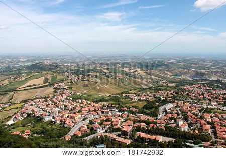 San Marino. Emilia-romagna. View on town with red roofs on blue sky background horizontal view