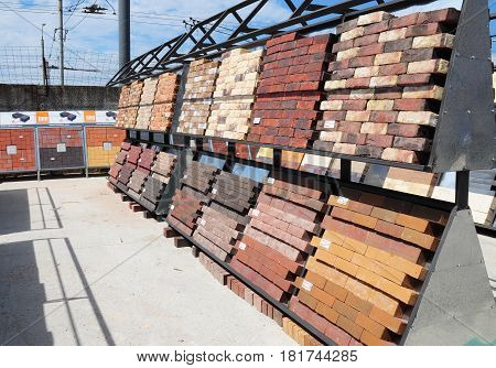KIEV - UKRAINE APRIL - 19, 2017: Stacks of various bricks pavement blocks for sale. Building and construction materials colored bricks concrete pavers organized on pallets for sale
