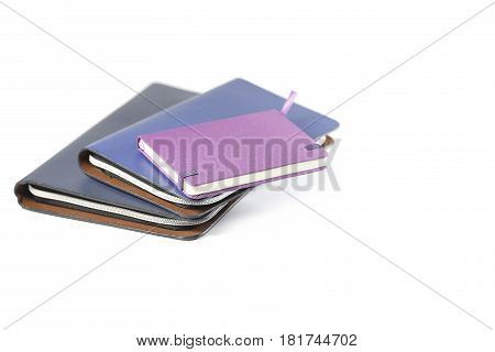 Notebooks arrangement isolated on white background, office items concept.