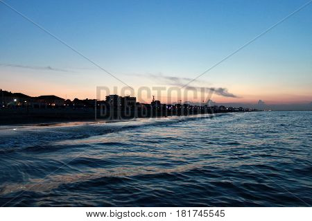 Italy. Emilia-Romagna. Rimini. Sea on blue pink sky background horizontal view. Sunset