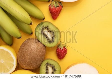 Fruit place for inscription. Fruits on a bright yellow background with the day of the inscription