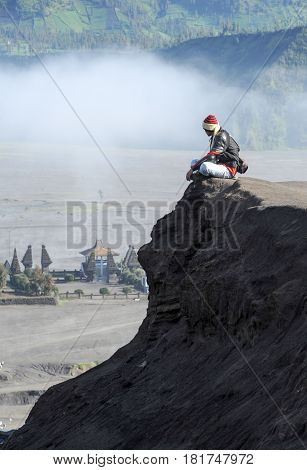 Man Sitting On A Hill Of Mt.bromo National Park