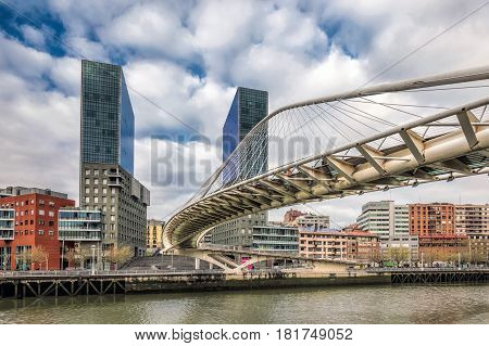 BILBAO, SPAIN - April 17, 2016: Zubizuri Bridge made by Santiago Calatrava in Bilbao, Spain, on February 27, 2015. It is a modern arch bridge that hangs over the river Nervin in Bilbao.