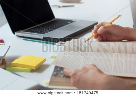 Woman reading a book. Education Academic Learning and Exam concept.