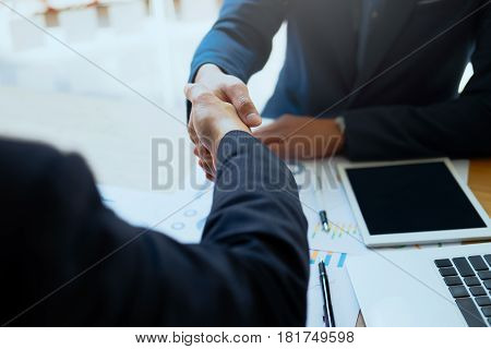 Successful Business Peolple Handshaking After Good Deal.