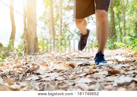 Trail Running Man Exercising Outdoors For Fitness.