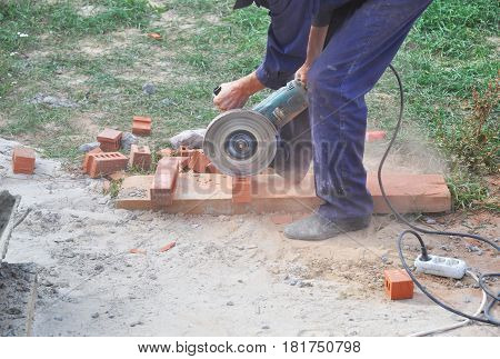 KIEV - UKRAINE APRIL - 19, 2017: Worker Cutting Bricks with a Diamond Saw. Masonry Cutting. Contractor Cut a Brick With a Wet Saw. Circular saw is a power-saw with disk.