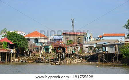 Slum Houses Staying On Stilts In The River