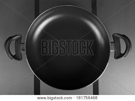 Shallow pot cuisine. Top view of frying pan with two handles