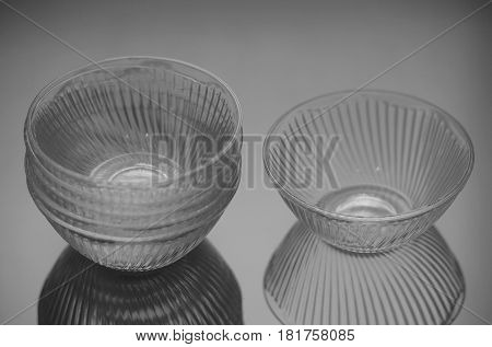 Set of six deep glassware on gray blurred background