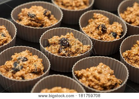 Wheat bran muffins preparation : Adding wheat bran muffins mix to the baking cups