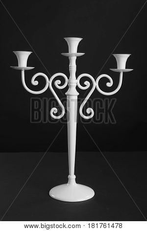 Antique white candlestick isolated on black background