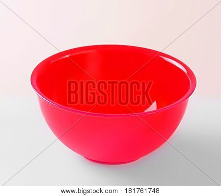 Red transparent plastic deep dish isolated on white background