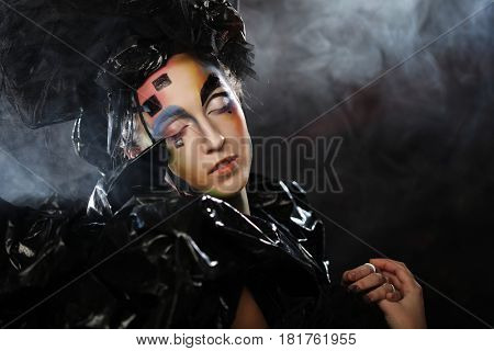 Portrait of young stylisn woman with creative visage.