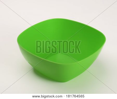 Green plastic deep dish isolated on white background