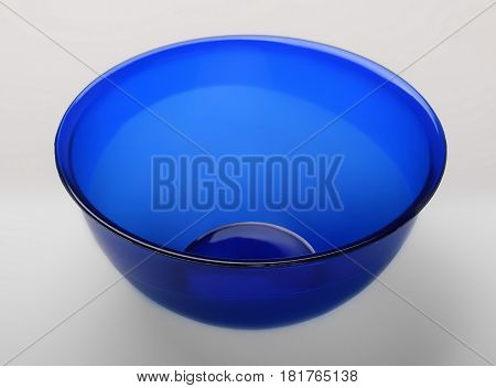 Blue transparent plastic deep dish isolated on white background