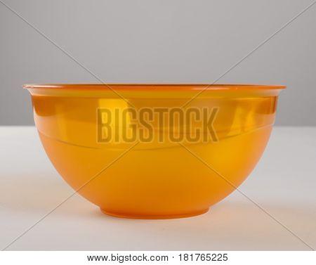 Orange transparent plastic deep dish front view